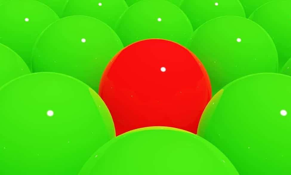 red ball in pile of green balls
