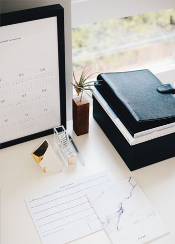 Desk With Notepads And Calendar