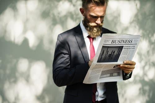 Bearded Business Man Reading Newspaper