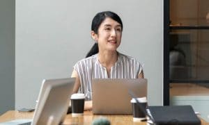 Asian Woman In Meeting Room